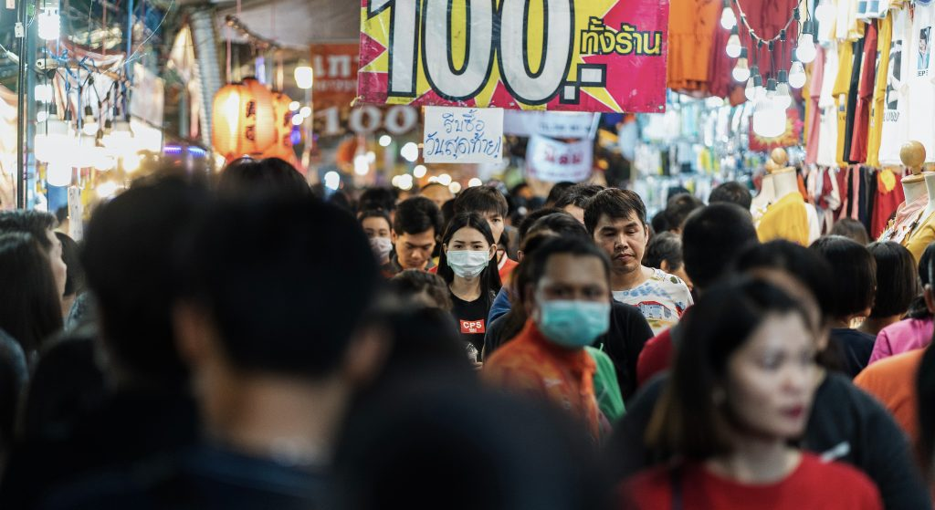 People wearing protective mask on street.